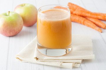 apple carrot juice in a glass on whte background
