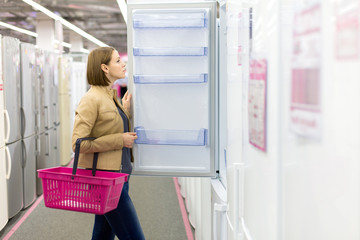 woman buys a refrigerator