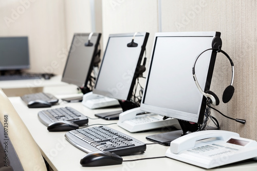 Computers With Headphones On Desk - 80733468