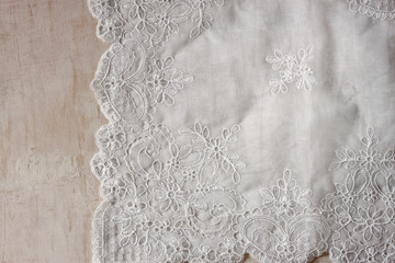 top view of vintage hand made beautiful lace fabric over wooden