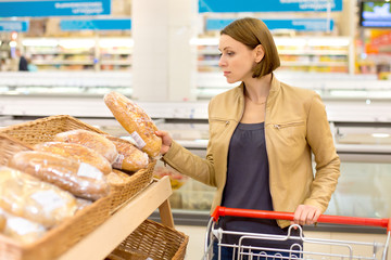 Woman bying bread
