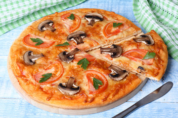 Vegetarian pizza with tomato and mushrooms