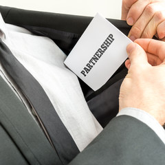 Closeup of businessman placing a business card with word Partner