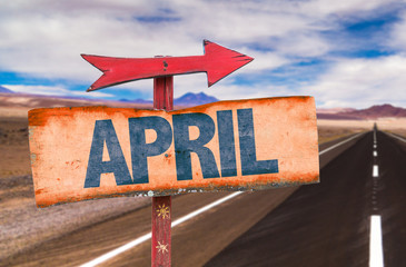 April sign with road background