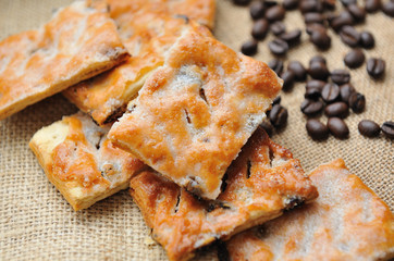 Cookies   with coffee beans on brown canvas.