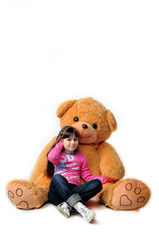 A girl sits with a bear