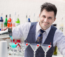 bartender pouring a cocktail drink