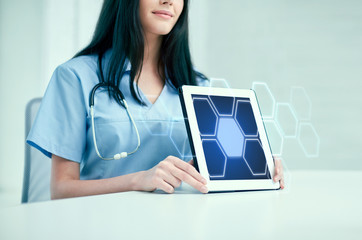 close up of doctor showing hologram on tablet pc