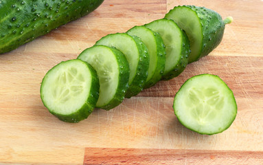sliced cucumber on a cutting board