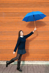 cheerful young woman with umbrella