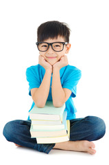 Asian school kid sitting on the floor with books