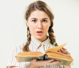 teen girl with open vintage book