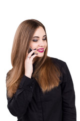 Girl talking on a mobile phone. Portrait of a girl with a