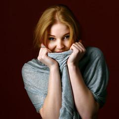 Portrait of blond winter beauty in light gray sweater