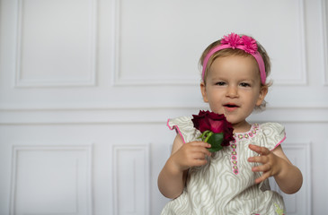 Little cute girl with red flower