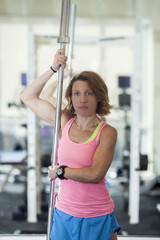 muscular woman with barbell