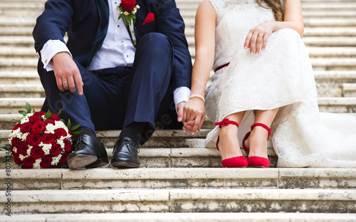 Unrecognizable young wedding couple holding hands - 80742448