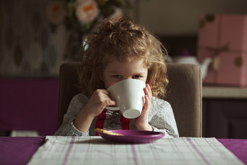 Little girl drinking from a cup