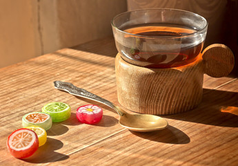 Cup of tea,  the Cup holder,candy,spoon.