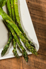 Grilled asparagus spears on plate