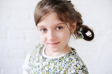 Portrait of brunette kid girl