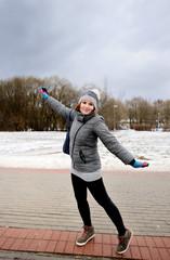 Happy young woman enjoying early spring walk