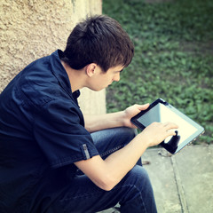 Teenager with Tablet outdoor