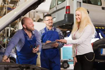 Service crew and happy driver