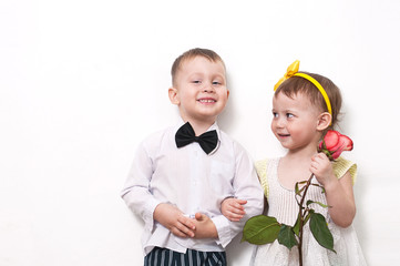. the boy gives a rose to the girl