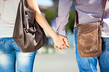 Young couple walking hand by hand
