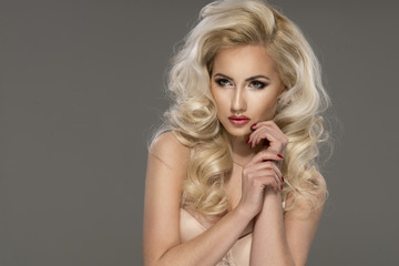 Portrait of beautiful  blonde woman with long curly hai