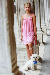 Portrait of fashion girl with maltese dog in Venice