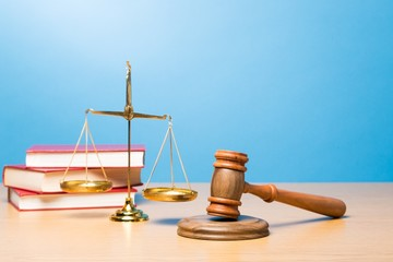 Lawyer. Law scales, judge gavel on table. Symbol of justice.
