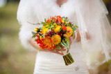 Orange wedding bouquet in hands