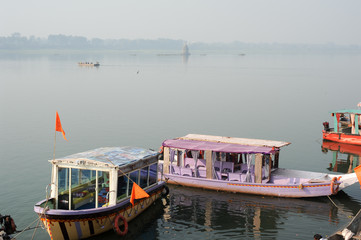 Boats on the sacred river Narmada at Maheshwar