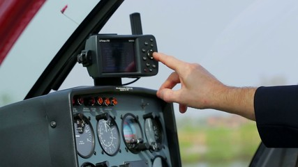 Pilot adjusts the instrument panel before taking off.