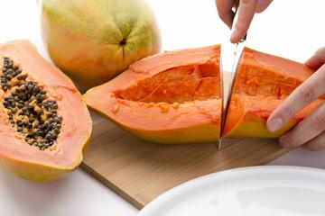 First Cut Through A Hollowed Out Papaya Half