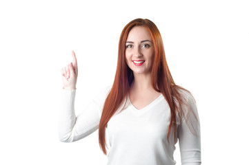 Happy redhead woman pointing up with her finger