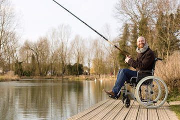 young man in a wheelchair fishing