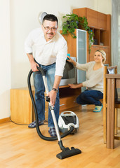 Spouses dusting and hoovering