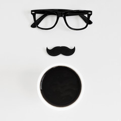 eyeglasses, moustache and cup of coffee