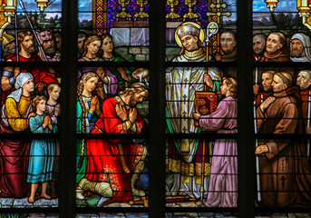 Stained Glass depicting the Sacrament of Baptism