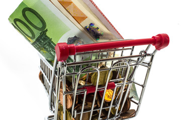 money European coins and banknotes in the shopping cart