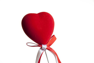 Heart shaped decoration with a bow on a stick