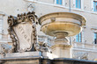 Leinwanddruck Bild - Oldest fountain in Rome on Piazza Santa Maria in Trastevere