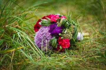 Wedding bouquet in the grass