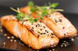 Grilled salmon on black plate - 80757494