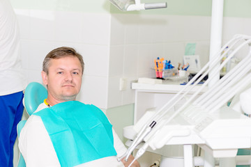 man in dentist office horizontal