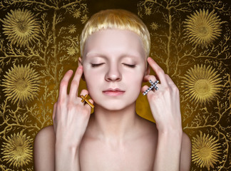 androgynous in the studio on yellow  textured background