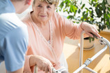 Nurse assisting disabled pensioner